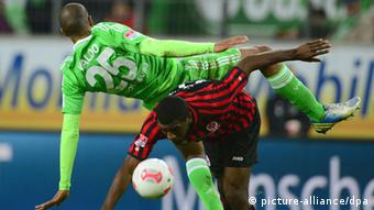 Naldo and Olivier Occean fight for the ball