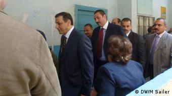 Interior Minister Ahmed Gamal El Din inspects a polling station