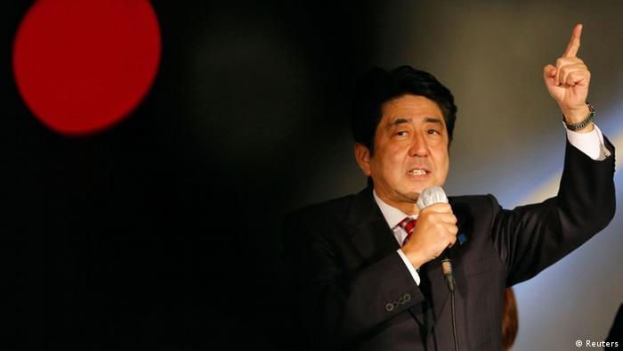 Japan's main opposition Liberal Democratic Party's (LDP) leader and former Prime Minister Shinzo Abe speaks to voters atop a campaign van at Akihabara electronics store district in Tokyo December 15, 2012, on the last election campaign day ahead of Sunday's general election.