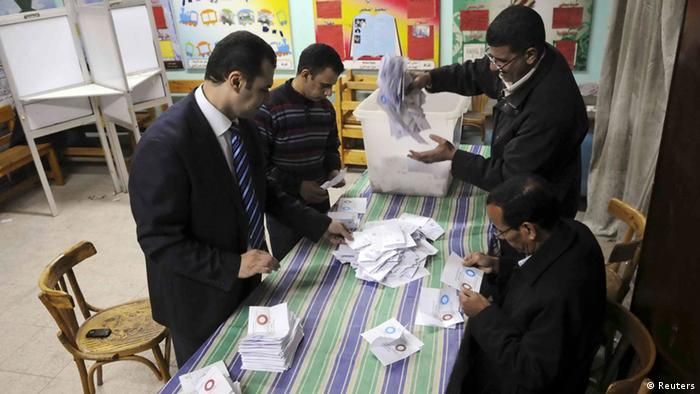 Officials count ballots after polls closed in Zagazig, about 62.5 km (38.8 miles) northeast of Cairo December 15, 2012.