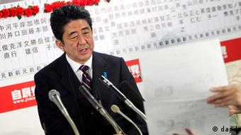 Japan's main opposition Liberal Democratic Party leader Shinzo Abe answers a reporter's question at the party headquarters in Tokyo, Sunday night, Dec. 16, 2012