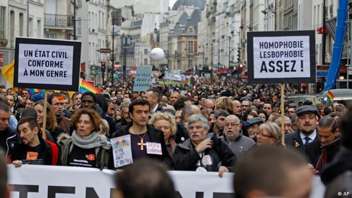 People demonstrate for the government project to legalize same-sex marriage and adoption for same-sex couples in Paris, Sunday Dec. 16, 2012. (AP Photo / Remy de la Mauviniere).