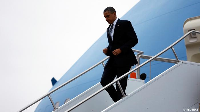 President Barack Obama exits Air Force one en route to Newtown (Reuters/Kevin Lamarque)