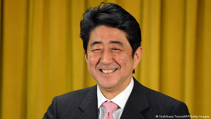 Japan's main opposition Liberal Democratic Party (LDP) leader Shinzo Abe smiles during a press conference at the LDP headquarters in Tokyo on December 17, 2012. Incoming Japanese prime minister Shinzo Abe came out fighting on December 17 after his sweeping election victory, saying there can be no compromise on the sovereignty of islands at the centre of a dispute with China. AFP PHOTO / Yoshikazu TSUNO (Photo credit should read YOSHIKAZU TSUNO/AFP/Getty Images)