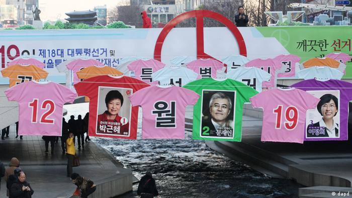 Election posters of presidential candidates Park Geun-hye (1) of the ruling Saenuri Party, Moon Jae-in (2) of the main opposition Democratic United Party and Lee Jung-hee (3) of the opposition Unified Progressive Party hang down Seoul's Cheonggye Stream, South Korea, Tuesday, Dec. 11, 2012. (Photo via AP/dapd)