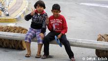 Children play along a roadblock (Photo: Reese Erlich)
