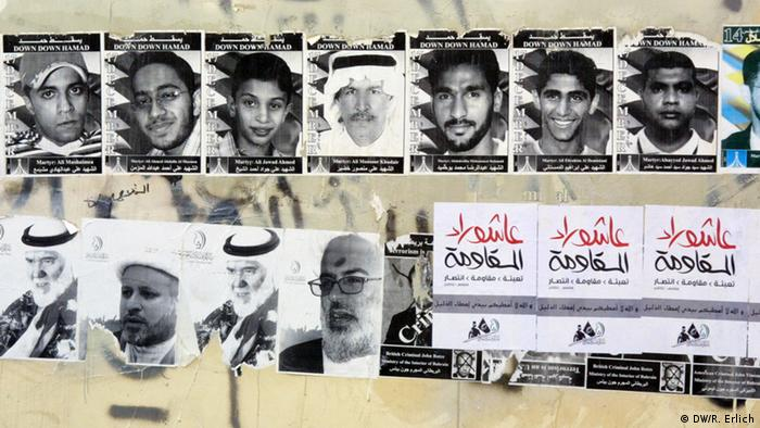 Posters of killed demonstrators on a wall (photo: Reese Erlich)