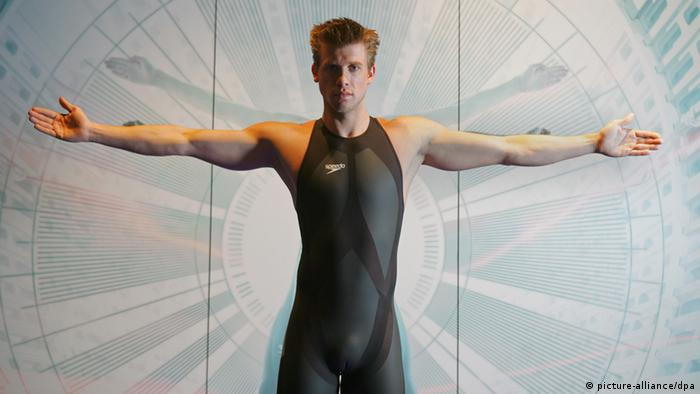 A swimmer poses in a full body swimsuit