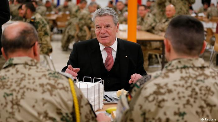 German President Joachim Gauck talks to soldiers serving in the German Armed Forces (Bundeswehr) contingent over breakfast during his visit to the International Security Assistance Force (ISAF) in Camp Marmal, near the northern Afghan city of Mazar-e-Sharif December 18, 2012. REUTERS/Fabrizio Bensch (AFGHANISTAN - Tags: MILITARY CIVIL UNREST POLITICS)