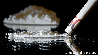 Montage of a 50 euro note rolled up near a line of cocaine Photo: +++(c) dpa - Bildfunk+++