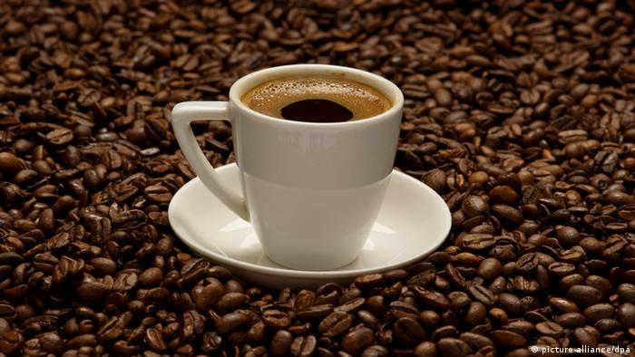 Cup of espresso on a pile of coffee beans .Photo: Soeren Stache/dpa