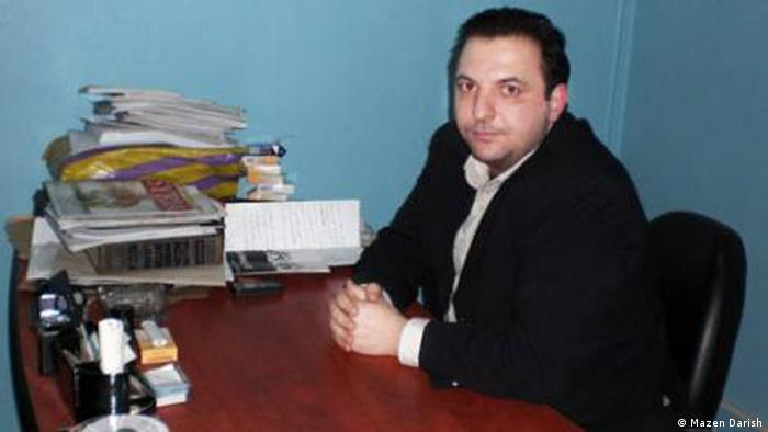 Mazen Darish, seated at a desk