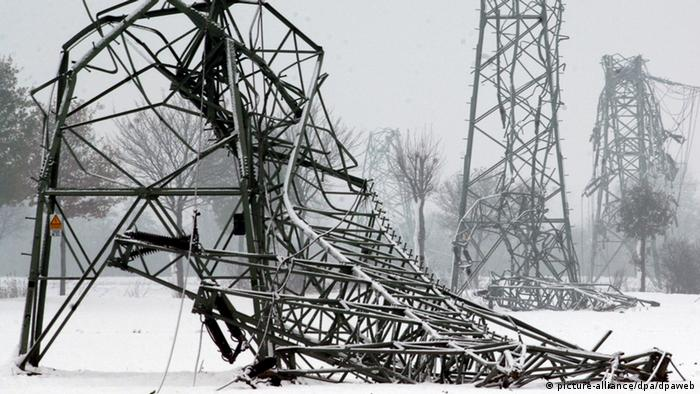 High voltage power masts collapse under the weight of heavy snow near the German town of Münster