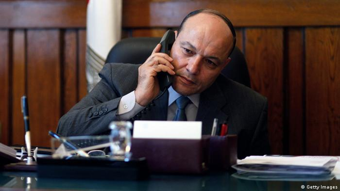 Newly appointed Egyptian prosecutor general Talaat Ibrahem Abdullah talks on the phone as he sits at his desk on his first day in office after being appointed by President Mohammed Morsi on November 24, 2012 in Cairo. MAHMOUD kHALED/AFP/Getty Images