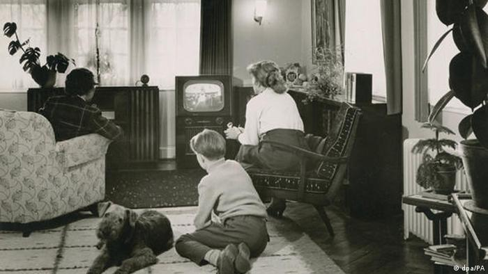 Family in front of tube TV