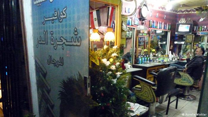 In a barber shop: Enjoy the view of an Xmas tree while getting your hair cut in Cairo Copyright: Aurelie Winker