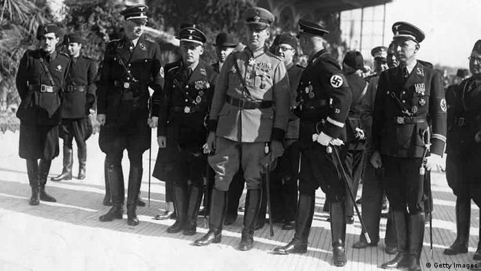 20th October 1936: Reinhard Heydrich (1904 - 1942), deputy Gestapo chief, also known as 'The Hangman', seen here in the centre of a group of German Police officials during a visit to the tomb of the unknown soldier in Rome. They are there to celebrate the anniversary of Rome's police corps. (Photo by Hulton Archive/Getty Images)