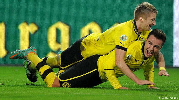 DORTMUND, GERMANY - DECEMBER 19: Mario Goetze of Dortmund celebrates with teammate Marco Reus after scoring his team's third goal during the DFB Cup match between Borussia Dortmund and Hannover 96 at Signal Iduna Park on December 19, 2012 in Dortmund, Germany. (Photo by Dennis Grombkowski/Bongarts/Getty Images)