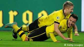 Mario Goetze of Dortmund celebrates with teammate Marco Reus after scoring his team's third goal during the DFB Cup match between Borussia Dortmund and Hannover 96 at Signal Iduna Park on December 19, 2012 in Dortmund, Germany. (Photo by Dennis Grombkowski/Bongarts/Getty Images)