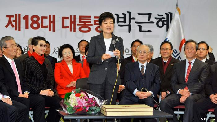 South Korea's president-elect Park Geun-Hye (C) from the ruling New Frontier Party, speaks during a ceremony to disband her election camp at the party headquarters in Seoul December 20, 2012. The daughter of a former military ruler won South Korea's presidential election on Wednesday and will become the country's first female leader, saying she would work to heal a divided society. REUTERS/Jung Yeon-Je/Pool (SOUTH KOREA - Tags: POLITICS ELECTIONS)