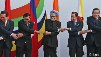 From left to right, Vietnam's Prime Minister Nguyen Tan Dung, Cambodia's Prime Minister Hun Sen, Indian Prime Minister Manmohan Singh, Brunei's Sultan Hassanal Bolkiah, and Indonesian President Susilo Bambang Yudhoyono, reach out each others hand as they pose for photos before the start of Association of Southeast Asian Nations (ASEAN) India commemorative summit, in New Delhi, India , Thursday, Dec. 20, 2012