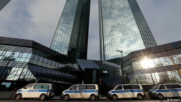 Police vehicles are parked outside the headquarters of Germany's largest business bank, Deutsche Bank AG in Frankfurt December 12, 2012. Deutsche Bank on Wednesday said its Frankfurt offices were being searched by prosecutors probing a tax evasion scheme involving the trading of carbon permits. The prosecutor said the probe related to severe tax evasion, money laundering and obstruction of justice, with the investigation targeting 25 employees of the bank. Deutsche Bank said it was cooperating fully with the authorities. REUTERS/Kai Pfaffenbach (GERMANY - Tags: BUSINESS CRIME LAW)