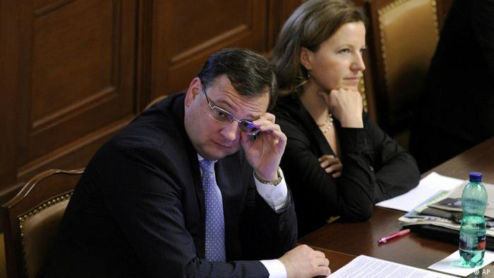 Czech Prime Minister Petr Necas, left, adjusts his glasses as Deputy Prime Minister Karolina Peake, right, looks on during a special parliament session in Prague, Friday, April 27, 2012. (AP Photo,CTK/Vit Simanek) SLOVAKIA OUT
