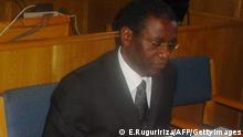 (FILES) -- A file photo taken on October 10, 2008 shows former Rwandan planning minister Augustin Ngirabatware (R) sitting next to his lawyer Cecil John Maruma (L) during his first appearance before the International Criminal Tribunal for Rwanda (ICTR) in Arusha. Ngirabatware, the son in law of the alleged financier of Rwanda's 1994 genocide, went on trial on September 23, 2009 charged with genocide and crimes against humanity. The genocide, in which extremists from the Hutu majority slaughtered minority Tutis and moderate Hutus, claimed some 800,000 lives in the space of 100 days.The ICTR, which is based in neighbouring Tanzania, was set up by the United Nations in the aftermath of the genocide to try the key suspects in the massacres. AFP PHOTO/Ephrem RUGURIRIZA (Photo credit should read EPHREM RUGURIRIZA/AFP/Getty Images)