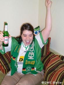 Nadia Paul cheering on Werder and drinking Becks