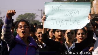 Activists of the National Students Union of India (NSUI) hold placards as they shout slogans condemning a recent act of alleged gang rape in Delhi. (Photo: EPA/JAIPAL SINGH pixel)