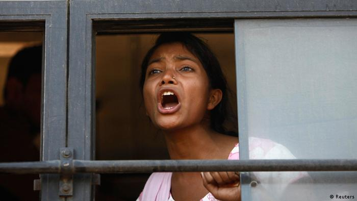 A demonstrator shouts slogans from inside a bus after she was detained by police near presidential palace Rashtrapati Bhavan during a protest rally organised by various women's organisations in New Delhi December 21, 2012. (Photo: REUTERS/Mansi Thapliyal)