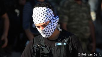 A masked Syrian rebel