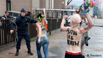 Activists from women's rights group Femen protest in front of the European Union Council building in a demonstration against the visit of Russian President Vladimir Putin in Brussels December 21, 2012. REUTERS/Francois Lenoir (BELGIUM - Tags: POLITICS CIVIL UNREST) TEMPLATE OUT