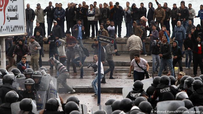 Egyptian riot police try to quell clashes between opponents and supporters of President Mohamed Morsi in the Mediterranean coastal city of Alexandria on December 21, 2012. MAHMUD HAMS/AFP/Getty Images