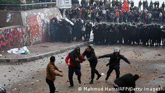 Egyptian riot police try to quell clashes between opponents and supporters of President Mohammed Morsi in the city of Alexandria on December 21, 2012