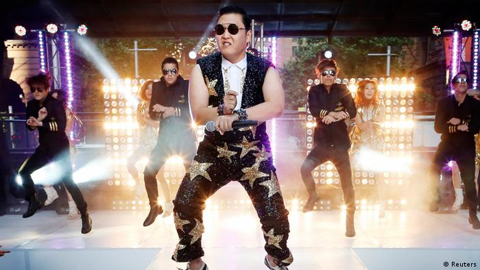 South Korean singer Psy performs his hit Gangnam Style during a morning television appearance in central Sydney in this October 17, 2012 file photo. Psy's infectious viral hit song, Gangnam Style, made history on December 21, 2012 as the first ever video on YouTube to reach 1 billion views, adding yet another record to the song's juggernaut journey into mainstream pop. Picture taken October 17, 2012. REUTERS/Tim Wimborne/Files (AUSTRALIA - Tags: ENTERTAINMENT)