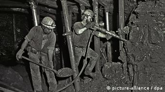 Historical black and white photo of two miners underground Photo: Oliver Berg dpa