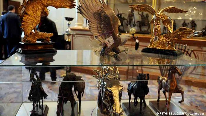 Decorative items that once belonged to ousted Tunisian dictator Zine El Abidine Ben Ali and his family are displayed at an auction in the Tunis suburb of Gammarth on December 22, 2012. Tunisian Prime Minister Hamadi Jebali kicked off viewing of thousands of luxury items once owned by the ousted leader and his family on the eve of a public auction, in a bid to raise millions of euros for government coffers. AFP PHOTO / FETHI BELAID (Photo credit should read FETHI BELAID/AFP/Getty Images)