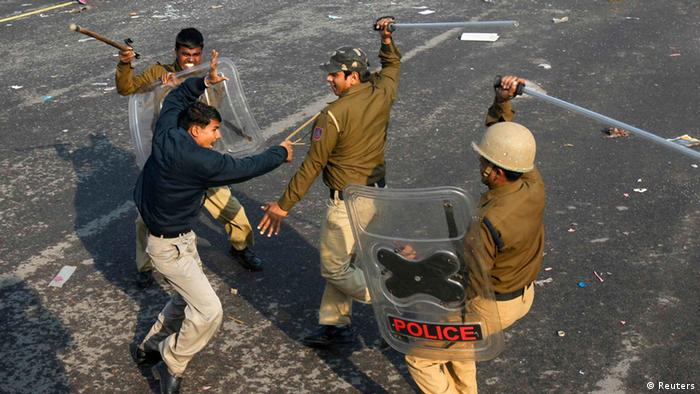 Police officers wield their batons against a demonstrator near the presidential palace during a protest rally in New Delhi December 22, 2012. Indian police used batons, tear gas and water cannon to turn back thousands of people marching on the presidential palace on Saturday in intensifying protests against the gang-rape of a woman on the streets and on social media. REUTERS/Mansi Thapliyal (INDIA - Tags: CRIME LAW CIVIL UNREST TPX IMAGES OF THE DAY)