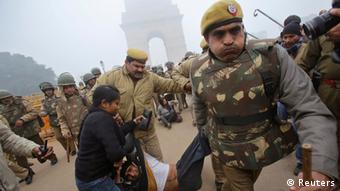 Police detain a demonstrator in front of the India Gate during a protest in New Delhi December 23, 2012. The Indian government moved on Sunday to stamp out protests that have swelled in New Delhi since the gang-rape of a young woman, banning gatherings of more than five people, but still thousands poured into the heart of the capital to vent their anger. REUTERS/Adnan Abidi (INDIA - Tags: CRIME LAW CIVIL UNREST TPX IMAGES OF THE DAY)
