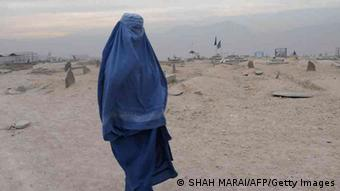 A burqa-clad Afghan woman walks in a cemetery Kabul on November 23, 2011. (Photo: AFP)