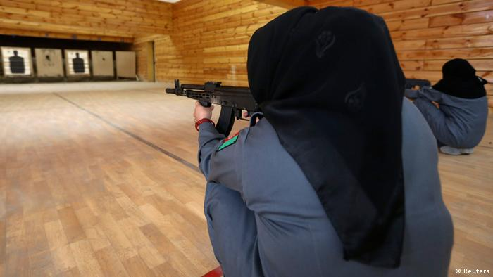 A picture of two Afghan policewomen aiming their guns at targets during shooting exercises at the Afghan National Police Academy shooting range, in Kabul December 9, 2012. (Photo via REUTERS/Omar Sobhani)