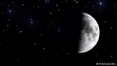 A photograph of a half-moon in the night sky