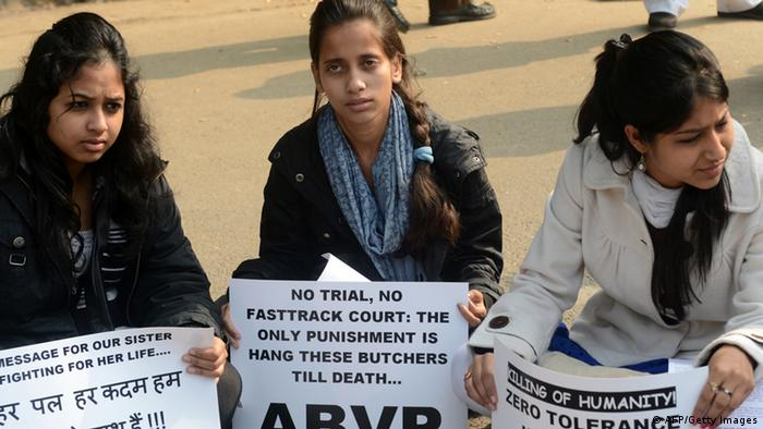 Indian demonstrators hold placards as they shout anti-government slogans during a protest calling for better safety for women in India in New Delhi on December 25, 2012, following the rape of a student in the Indian capital. An Indian policeman injured in clashes during a protest over a gang-rape in New Delhi has died a police spokesman said, as much of the city centre remained sealed off following the violence. AFP PHOTO/RAVEENDRAN (Photo credit should read RAVEENDRAN/AFP/Getty Images)