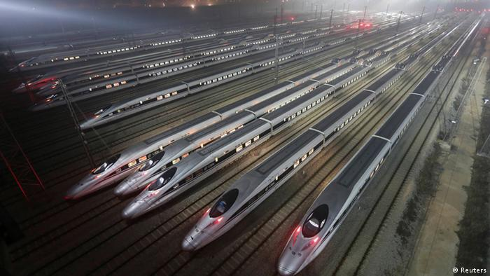 CRH380 (China Railway High-speed) Harmony bullet trains are seen at a high-speed train maintenance base in Wuhan, Hubei province, early December 25, 2012. China will open the world's longest high-speed rail line this week when a link between Beijing and the southern metropolis of Guangzhou is inaugurated, officials said on Saturday, underscoring its commitment to a trouble-plagued transport scheme. Rail investment slowed sharply in the wake of that accident and state media reported earlier this year that the government had cut planned railway investment by 500 billion yuan ($80.27 billion) to 2.3 trillion yuan under a five-year plan to 2015. REUTERS/Stringer (CHINA - Tags: TRANSPORT SOCIETY BUSINESS TPX IMAGES OF THE DAY) CHINA OUT. NO COMMERCIAL OR EDITORIAL SALES IN CHINA