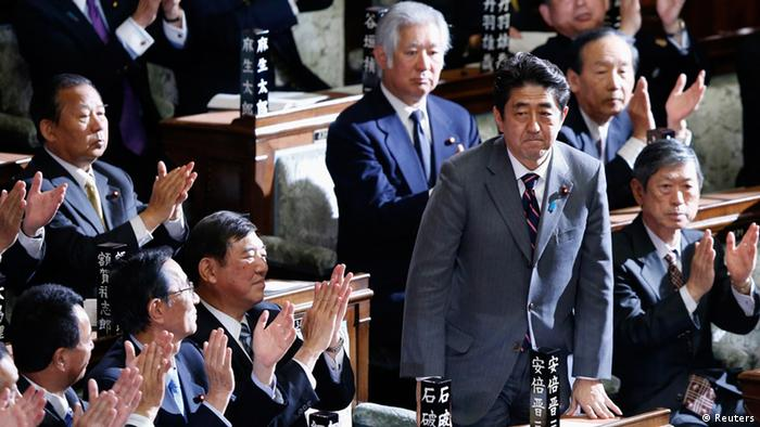 Japan's newly-elected Prime Minister Shinzo Abe stands as he was chosen as new prime minister at the Lower House of Parliament in Tokyo December 26, 2012. Former Japanese Prime Minister Abe was elected prime minister by parliament's lower house on Wednesday, giving the 58-year-old security hawk a second chance at running the world's third-biggest economy. REUTERS/Toru Hanai (JAPAN - Tags: POLITICS BUSINESS)