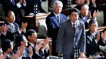 Japan's newly-elected Prime Minister Shinzo Abe stands as he was chosen as new prime minister at the Lower House of Parliament in Tokyo December 26, 2012. (Photo: REUTERS/Toru Hanai)