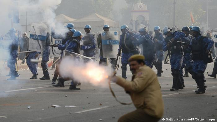 Indian police fire tear gas at demonstrators during a protest calling for better safety for women following the rape of a student last week, in front the India Gate monument in New Delhi on December 23, 2012. (Photo: SAJJAD HUSSAIN/AFP/Getty Images)
