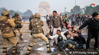 Delhi police lathi charge to disperse protestors during a protest against the Indian governments reaction to recent rape incidents in India, in front of India Gate on December 23, 2012 in New Delhi, India. (Photo by Daniel Berehulak/Getty Images)