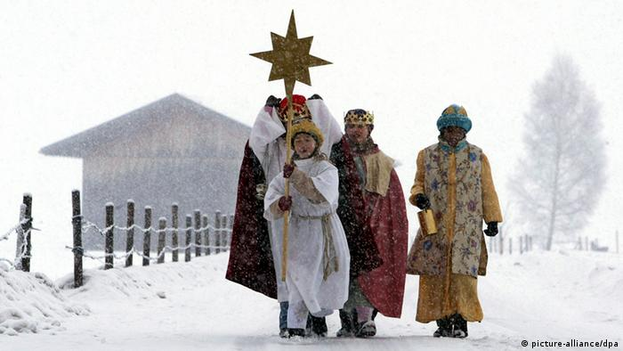 Sternsinger dressed as the Three Wise Men carry stars on their symbolic journey to Bethlehem
